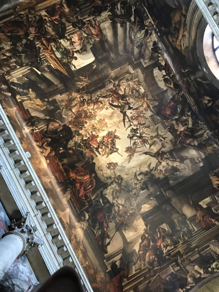 Lazzarini's masterpiece canvas in San Pantalon church. The largestceiling canvas painting in the world, depicting The Martyrdom and Apotheosis of St Pantalon.