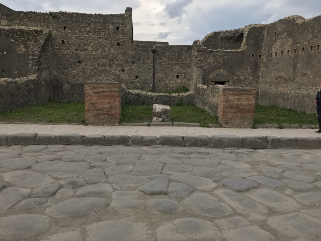 Houses and shops lined the streets of Pompeii. Many middle class houses seem to have a shop on the first floor and residence on the second floor. The lines of holes on the walls were slots for wooden beams that held the second floor.