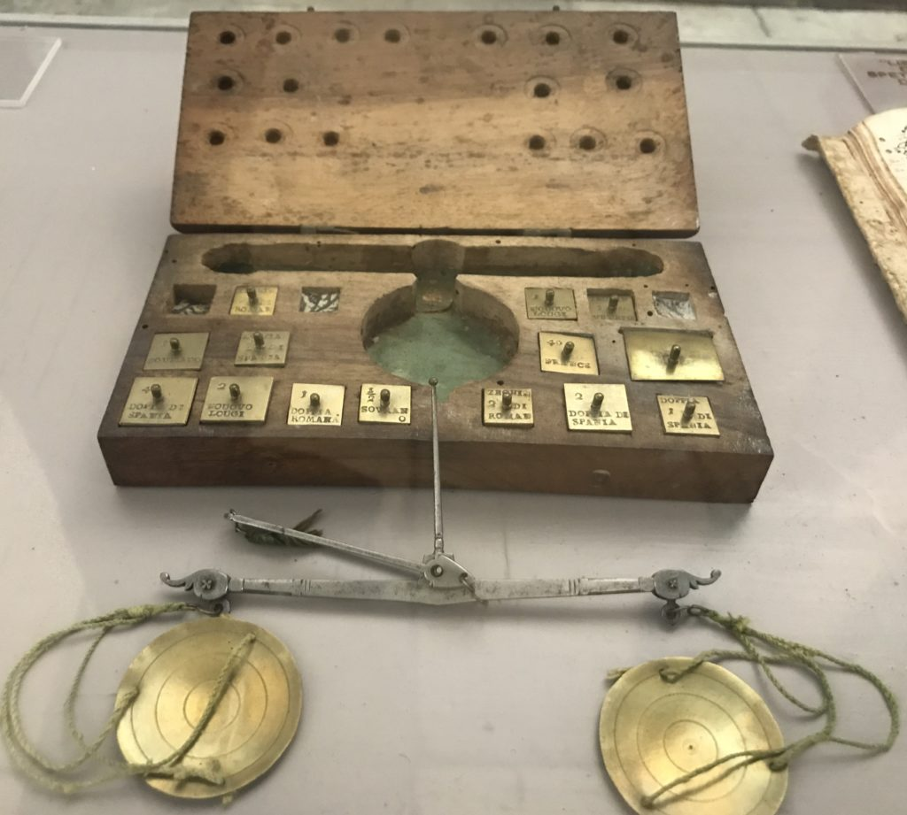 A weighing scale and weights in the Dubrovnik pharmacy & museum.