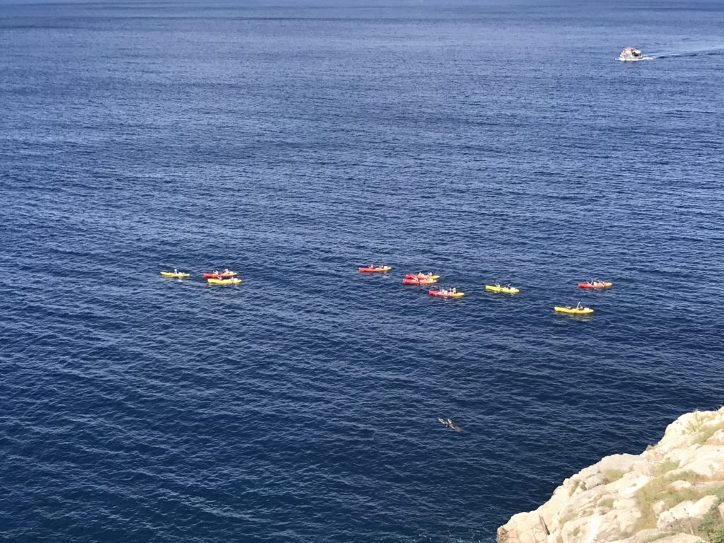 The colorful kayaks look so pretty in the deep blue water as we look down from the cafe on the Dubrovnik wall.