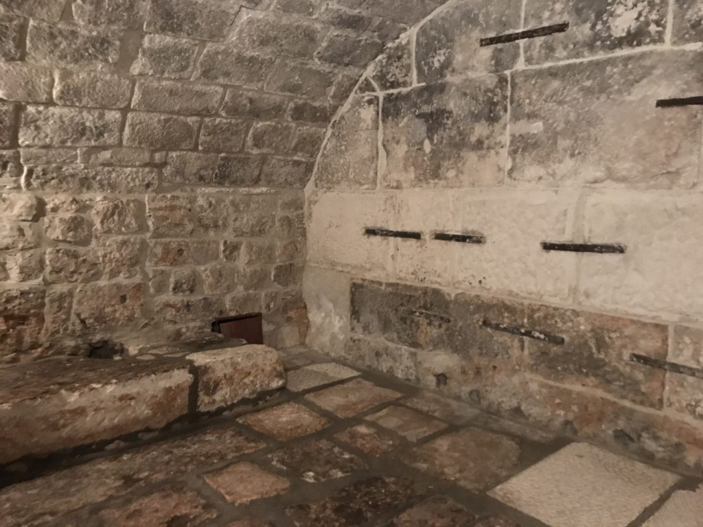 The dungeon is pretty small and depressing with a tiny door and a tiny window, all set behind another wall in the basement of the Rector palace.