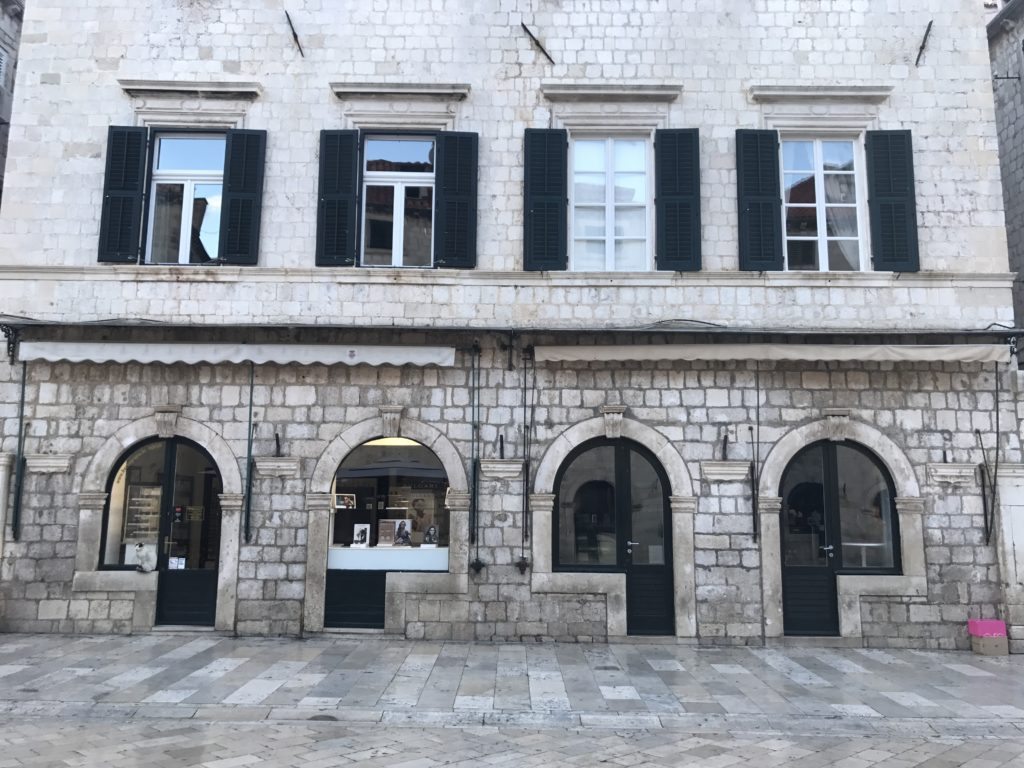 Most of the buildings on Dubrovnik's main road look the same, for centuries. Notice the entrances.