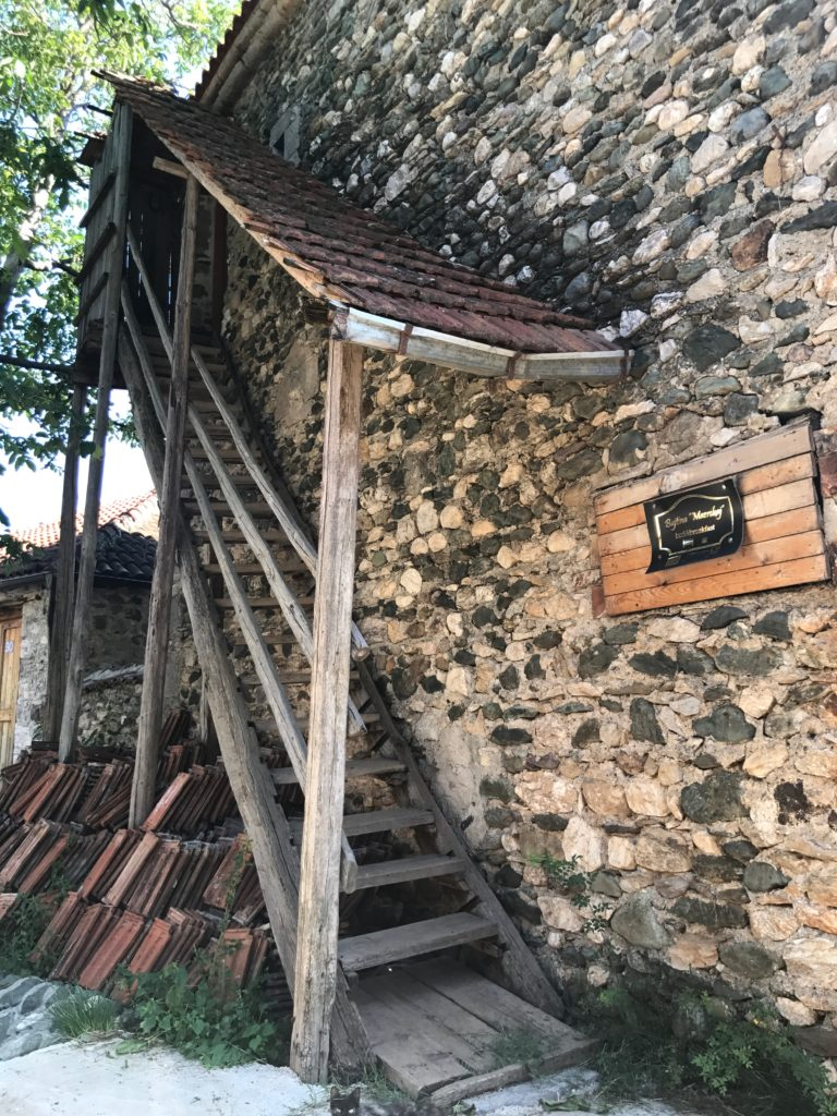 Exterior stairs leading up to the third floor. The third floor also has a direct entrance from the street, so guests can be welcomed on the third floor without passing through the residence. People in this village, even elderly, must be very fit to be climbing steps all the time.