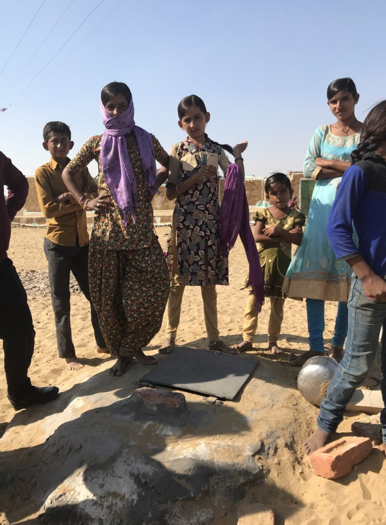 The drinking water well is probably the most important site as the children proudly share with us.