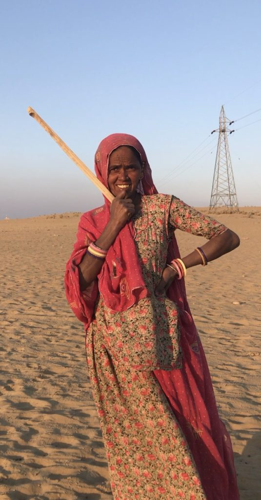 She is now heading home after tucking her cows to bed in the dunes. She herded the cows from all around up the dunes. She says they'll stay there all night and not get lost in the desert.
