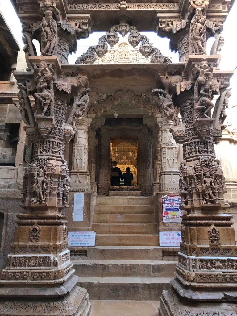 The entrances for the Jain temples of Jaisalmer are exquisite with several arches carved from golden stone.
