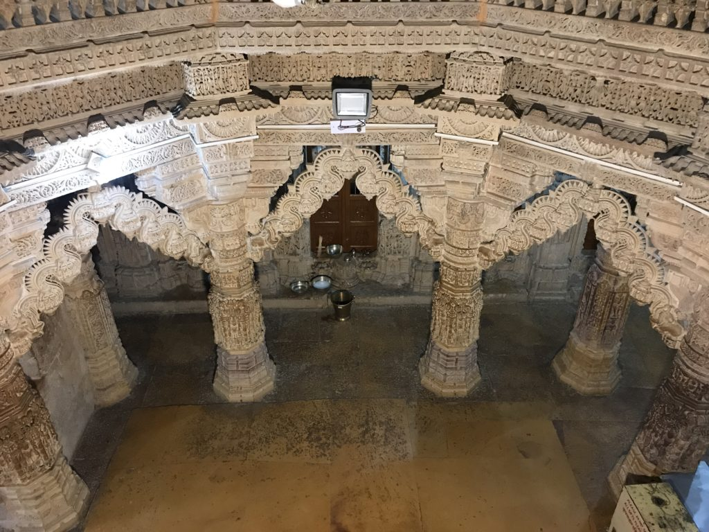 Looking down from the second floor, its easier to see part of the circle of arches in the center of a Jain temple in Jaisalmer Fort.