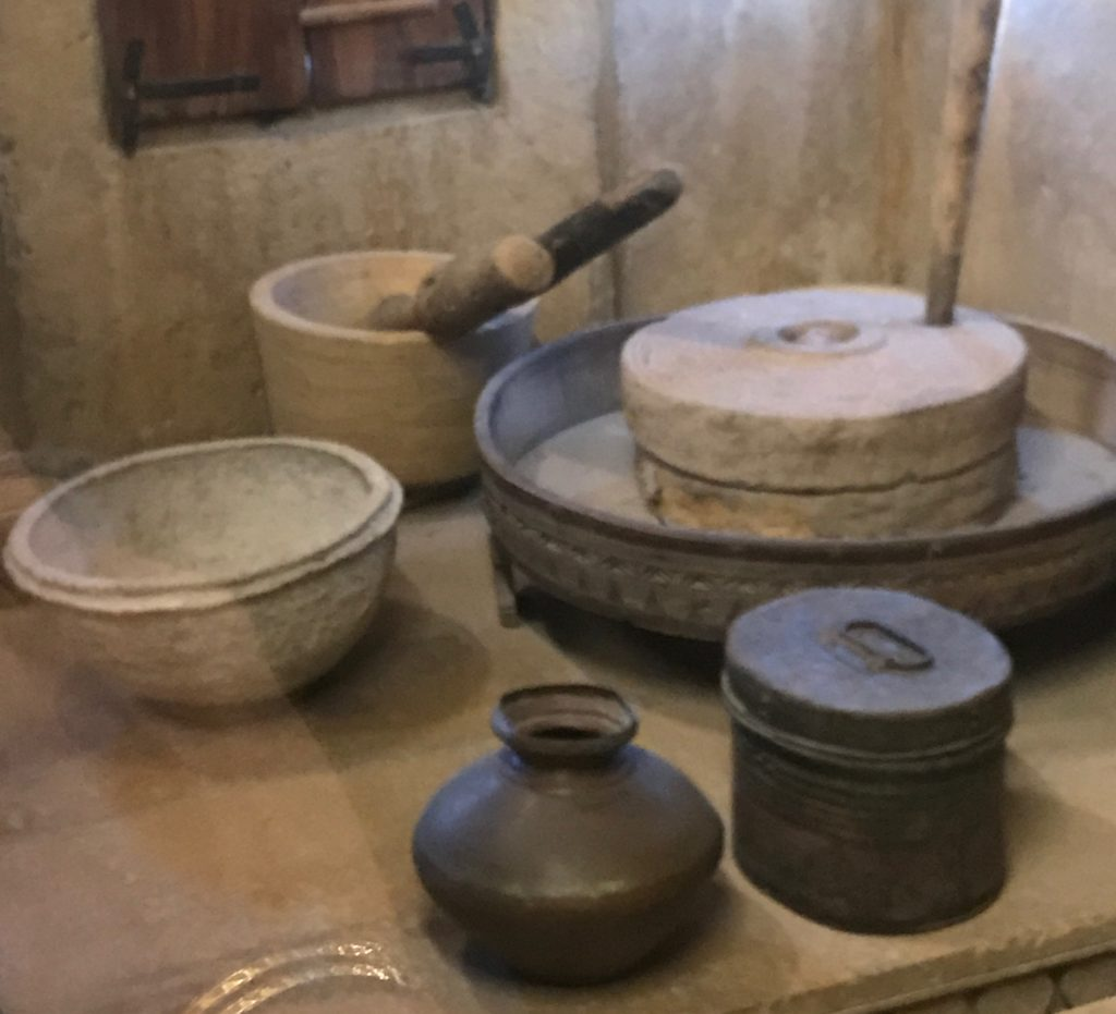 The kitchen had many gadgets, some common in Rajasthani kitchens and others only found in wealthy merchant homes. To the right is a grain grinder for making flour. It was very common in Rajasthan to make fresh flour each day. My grandfather used it as a great workout, every morning.