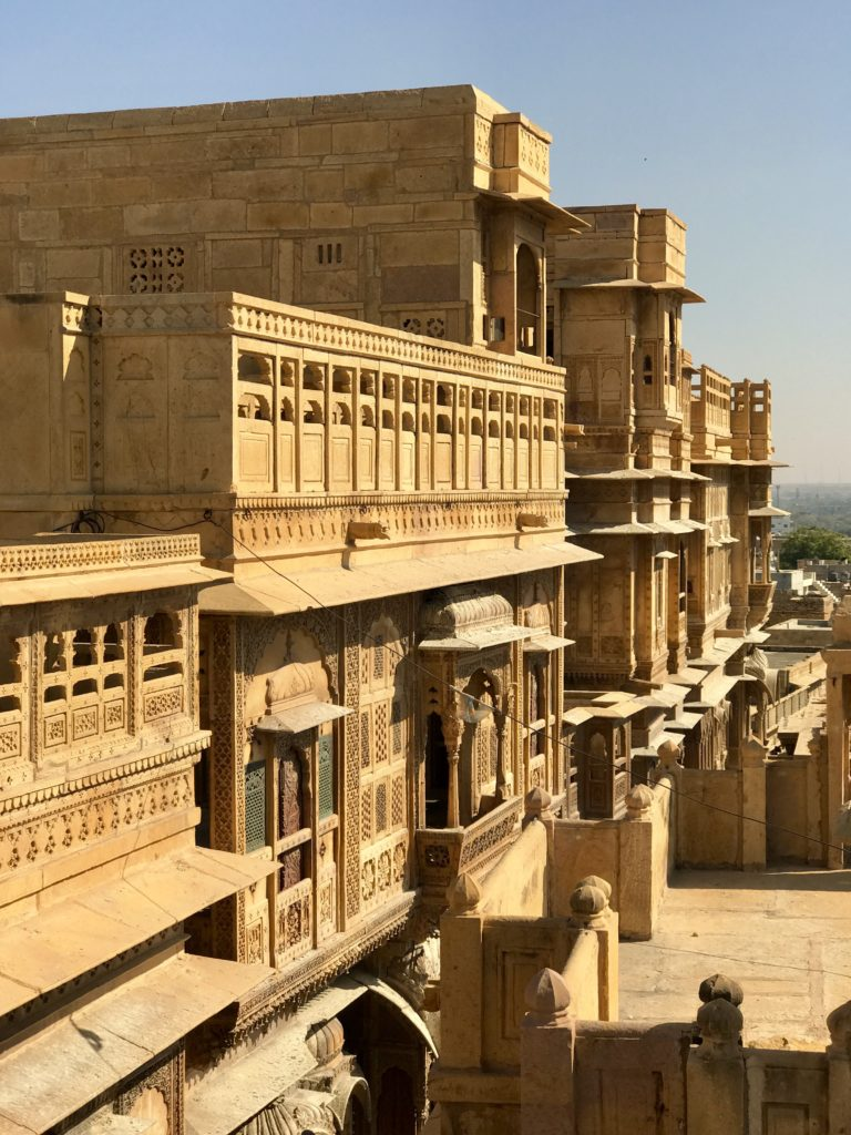 The rooftop provides a nice view of the Haveli, the neighborhood, the busy street below and the entire city.