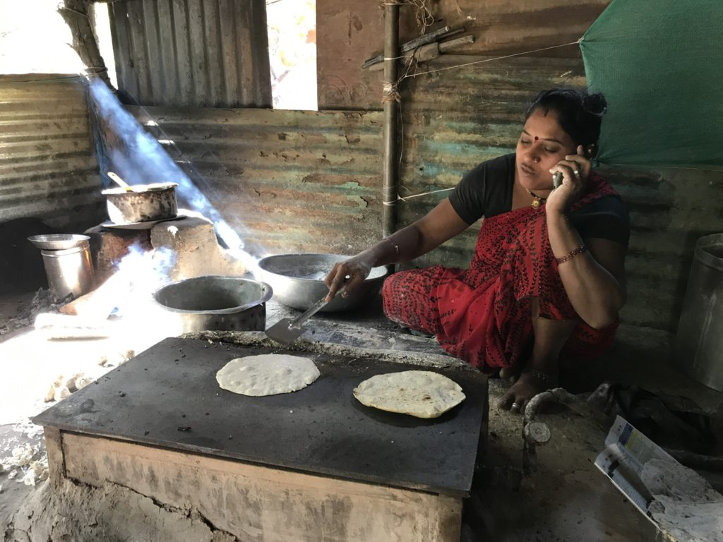 Another lady making fresh bhakri for her clients.