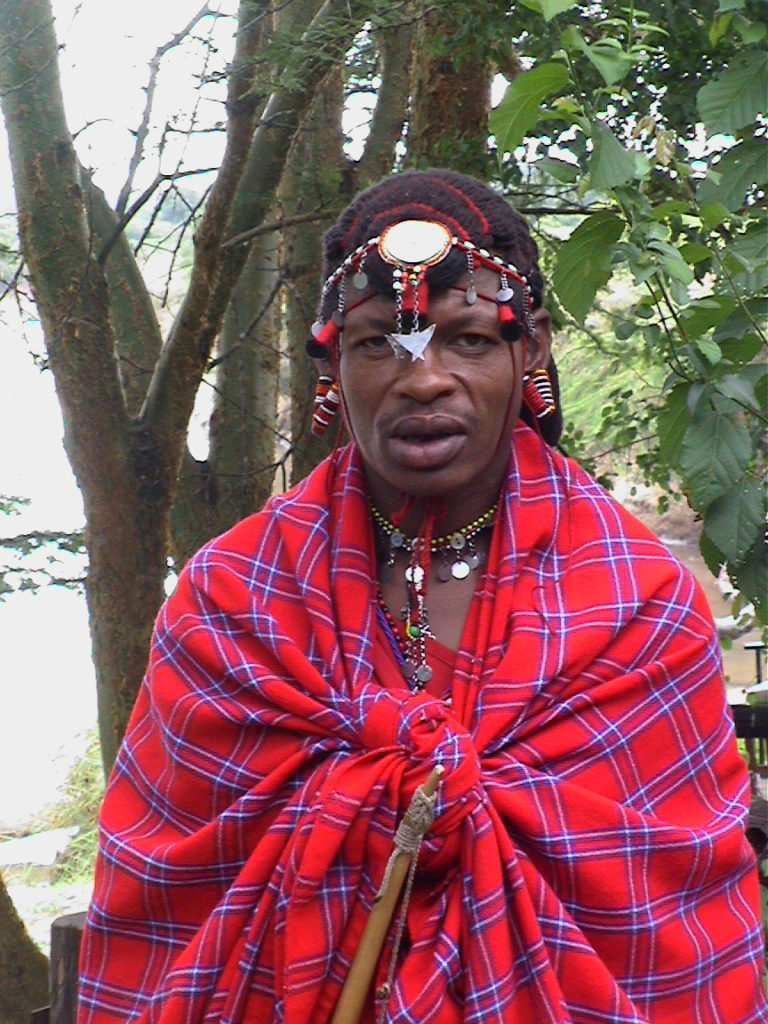 A Maasai male in traditional outfit.