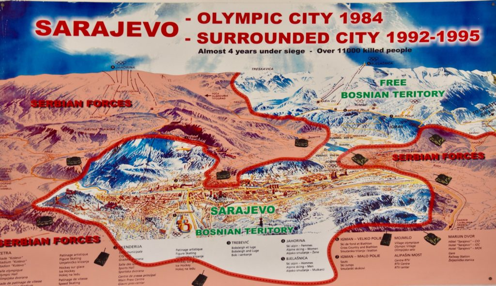 The pink sections show the area occupied by Serbian forces. They surrounded Sarajevo almost entirely, in some places right to the heart of the city (by Sniper Ally). Notice the tiny section near the top right linking Sarajevo to the rest of the free Bosnia area.