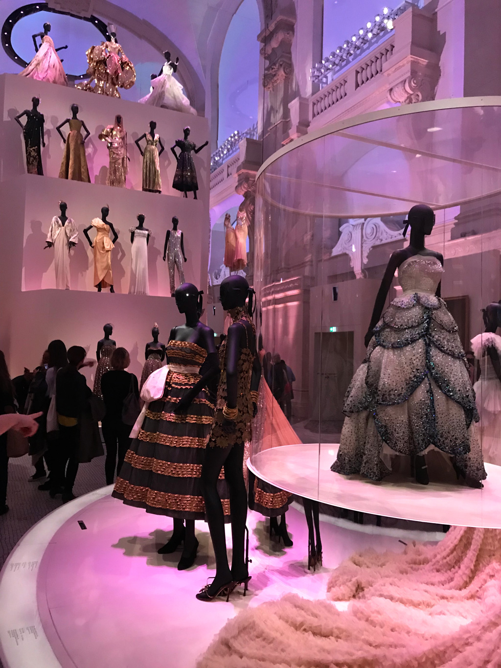 The final and main hall exhibiting Christian Dior dresses in the ultimate display of French fashion.