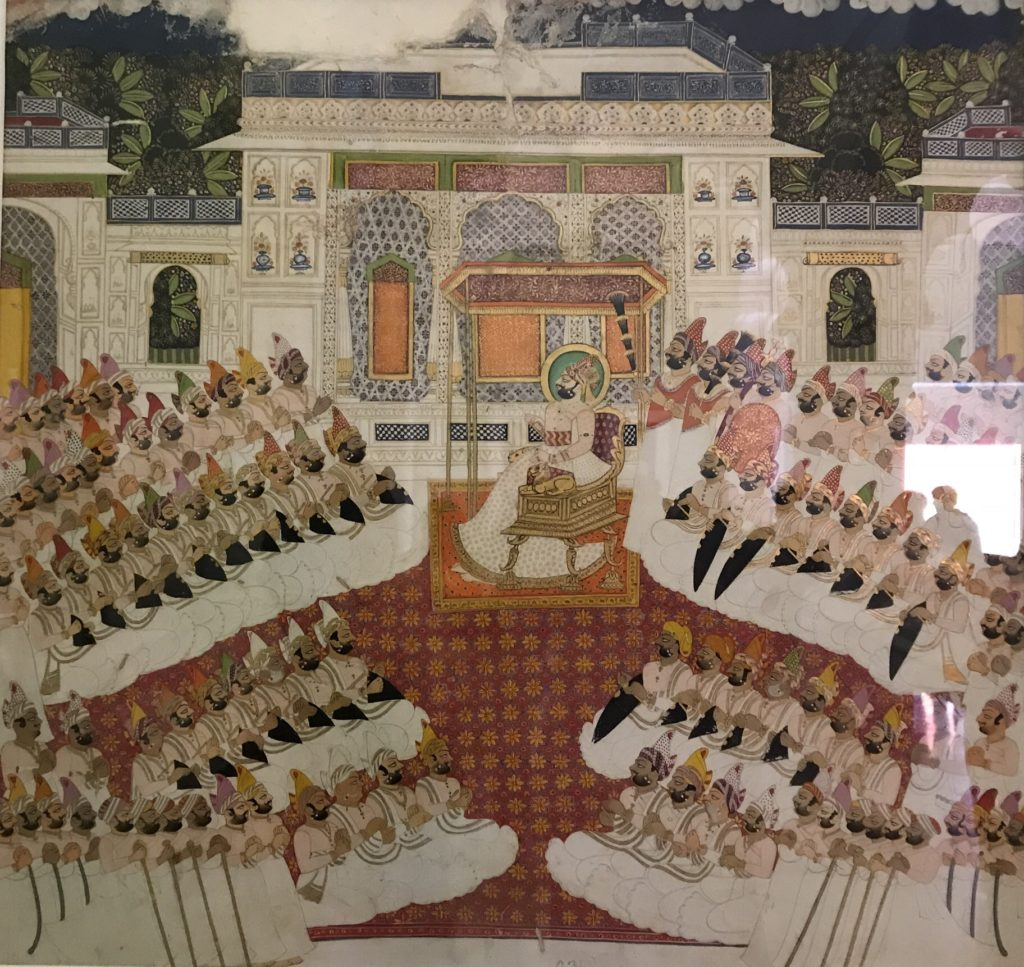 The grand King's court of Jodhpur reflects diversity in its people, with the many turban styles and skin color.