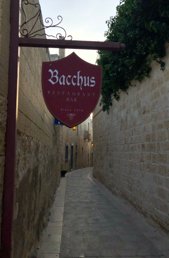 Thank goodness for the sign of Bacchus, we could find the tiny lane to turn.