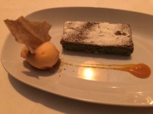 The pistachio cake served with sorbet and a sauce was absolutely amazing.