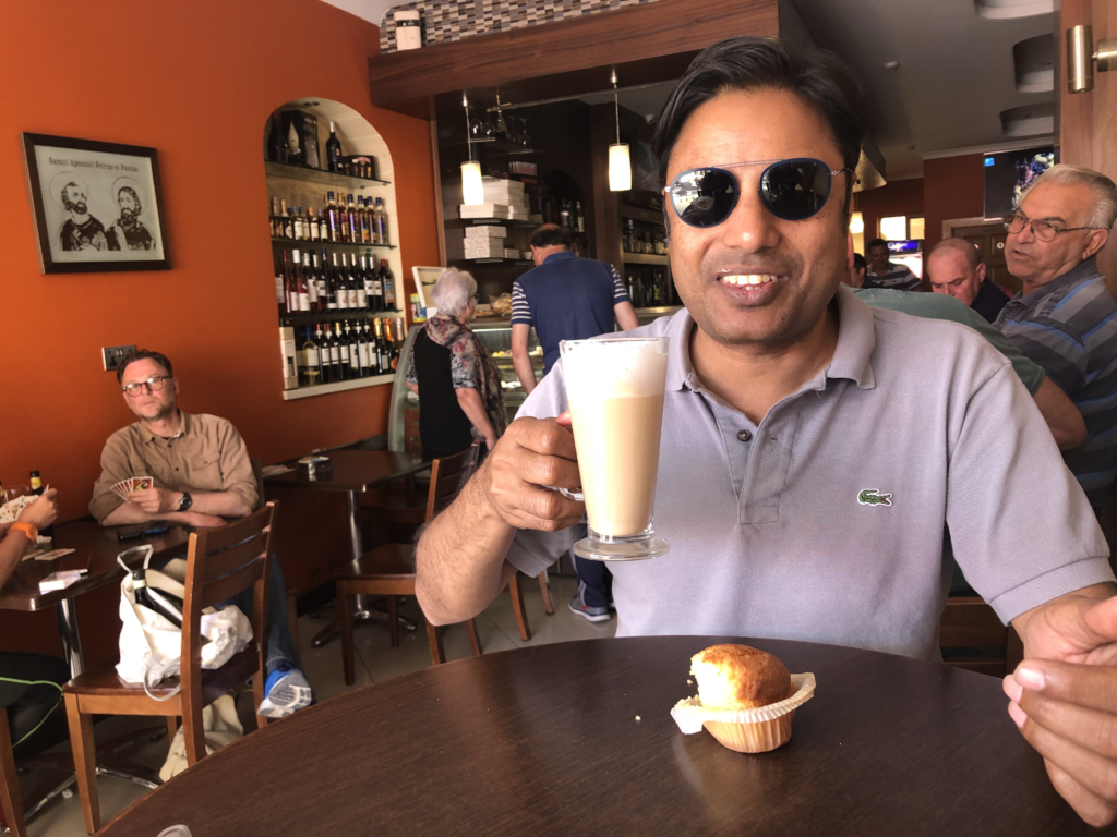 Sipping a delicious cup of coffee in a cafe in Nadur village in Gozo, Malta... with coconut muffins from Merken bakery.