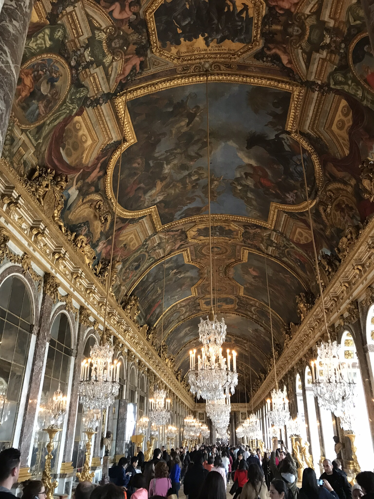 Versailles's gorgeous Hall of Mirrors is out of this world gorgeous and cozy warm in Paris's winter weather.