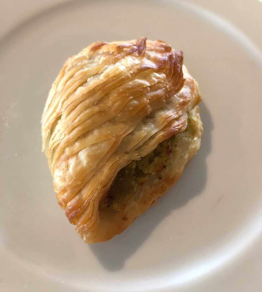 Maltese Pastizz is a traditional savory pastry filled with peas, ricotta or spinach filling.