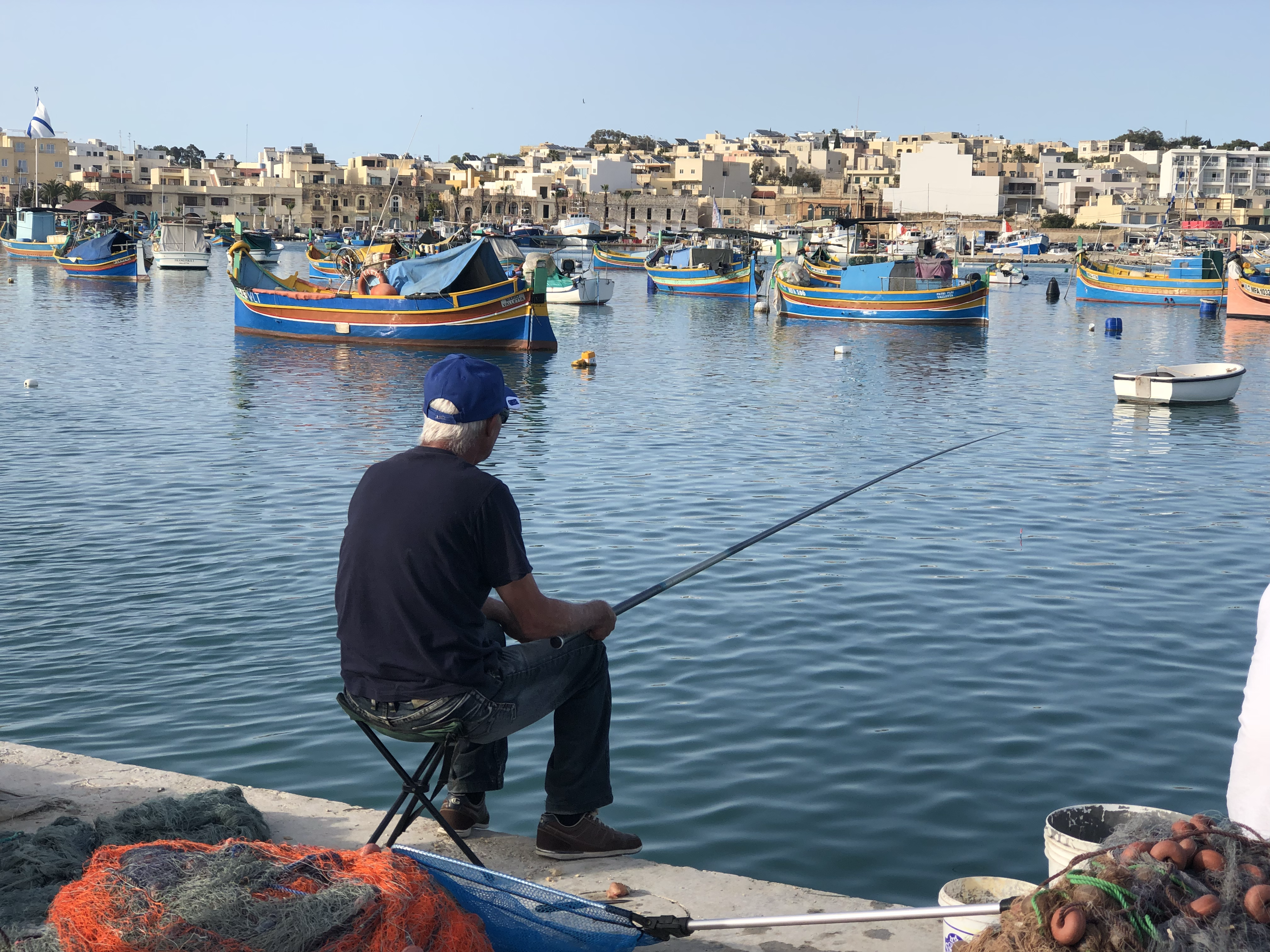 Leisurely life, sitting on the dock of the bay, fishing all day in Marsaxlokk.