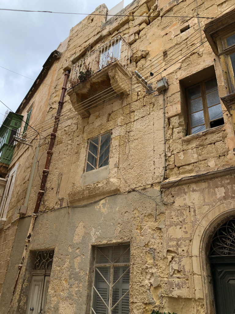 He's probably right to be concerned for our wellbeing. This Birgu, Malta house does look ancient and fragile.
