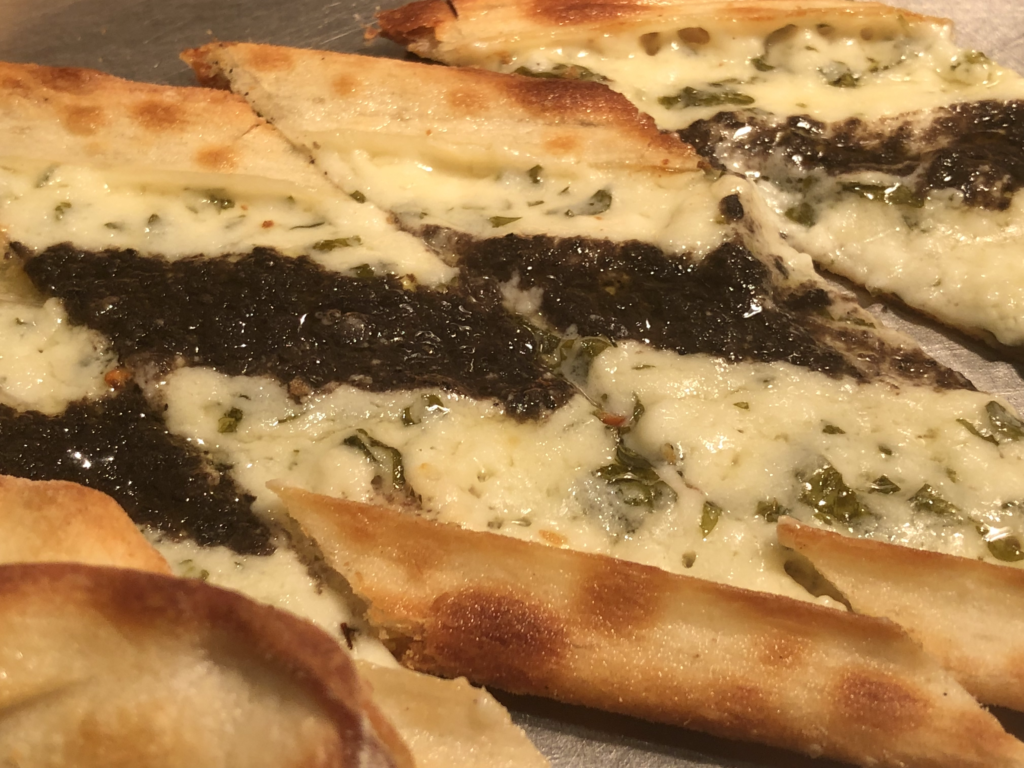 Our favorite is the pide that made live every half an hour. The cheese and parsley pide topped with basil sauce is my family's favorite.