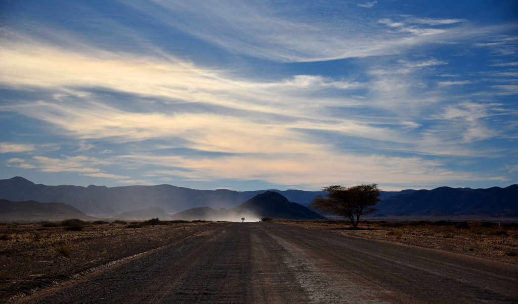 Driving along the vast, empty and open Namibian country side.