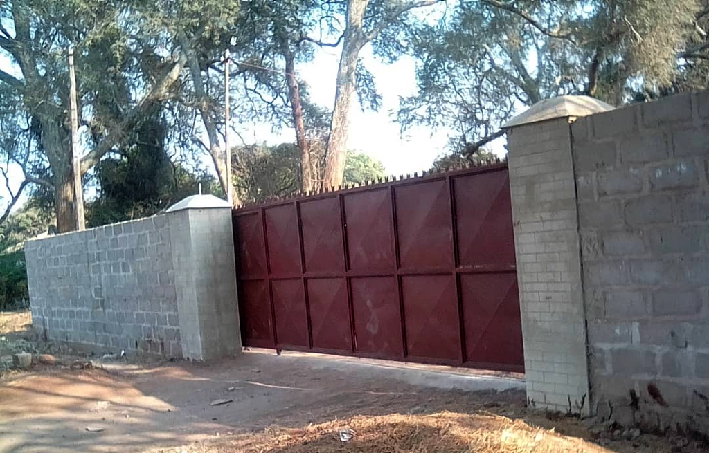 A gate and fence built by Physiwell and his team of Zambian entrepreneurs.
