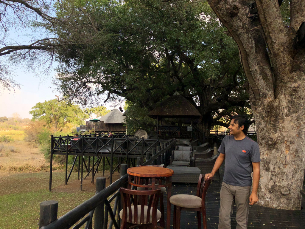 The outdoor cafe with views of the Kruger National park, the sitting huts, and the spa hut.