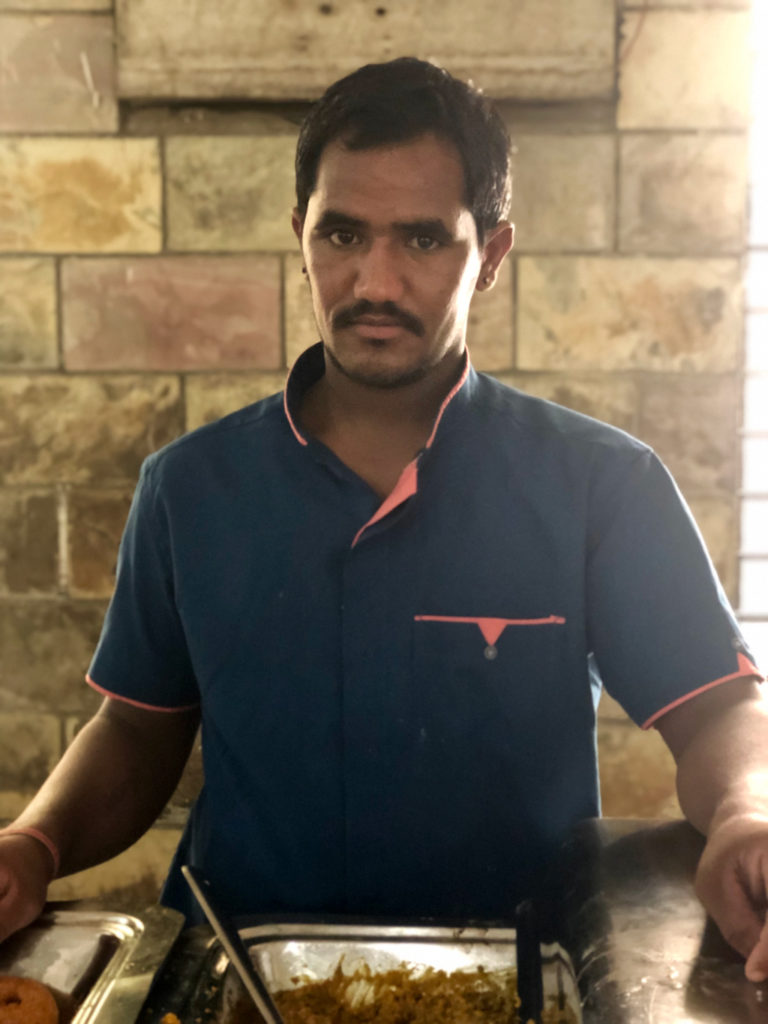 A staff member of the kitchen and bhojanshala in Kulpakji, the important Jain tirth of South India