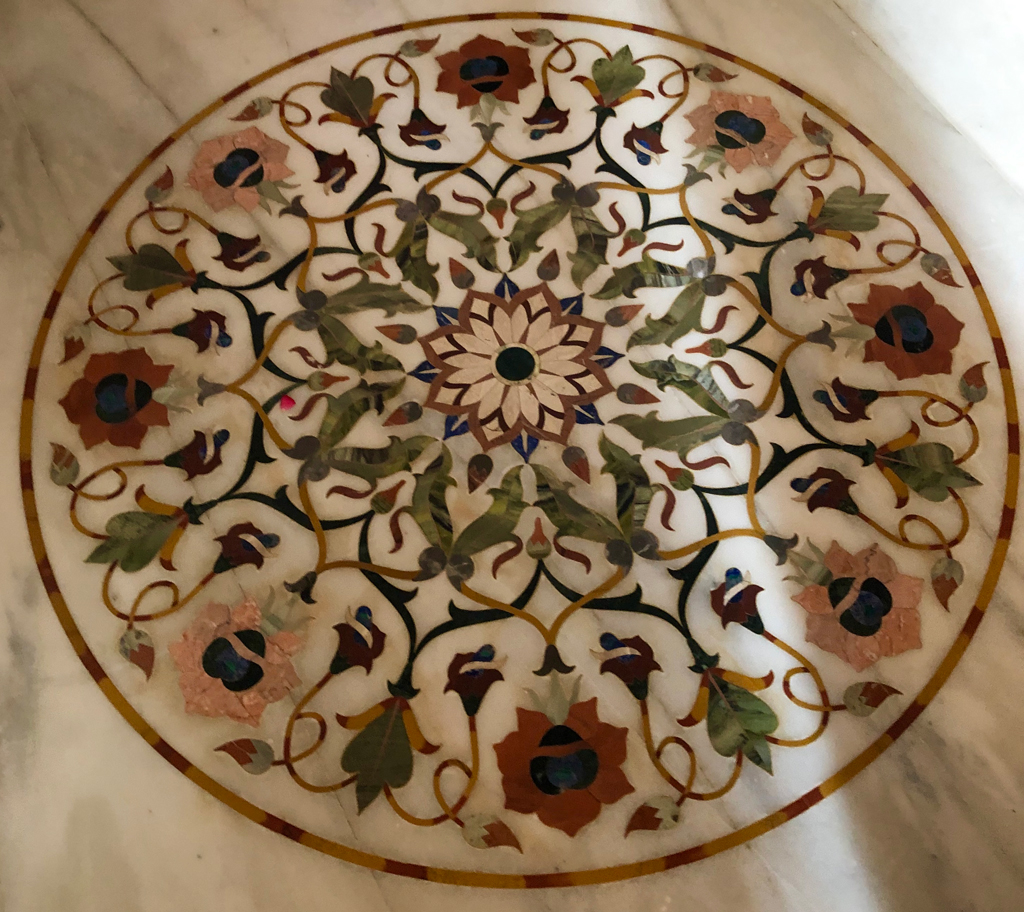Dozens of Taj Mahal style intricate marble inlay designs can be found all over the Kolunapaka Jain temple.
