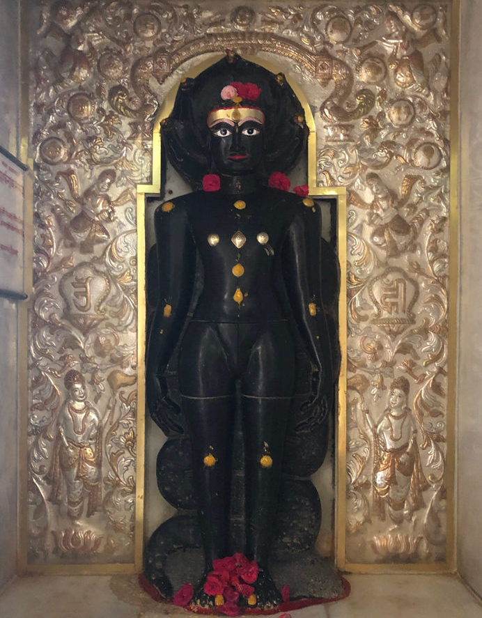 Siri Parshvnath Bhagwan's statue in Kulpakji is made of black granite rock in the usual standing posture with 5 snake fangs above his head. I was made in the 10th or 11th statue.