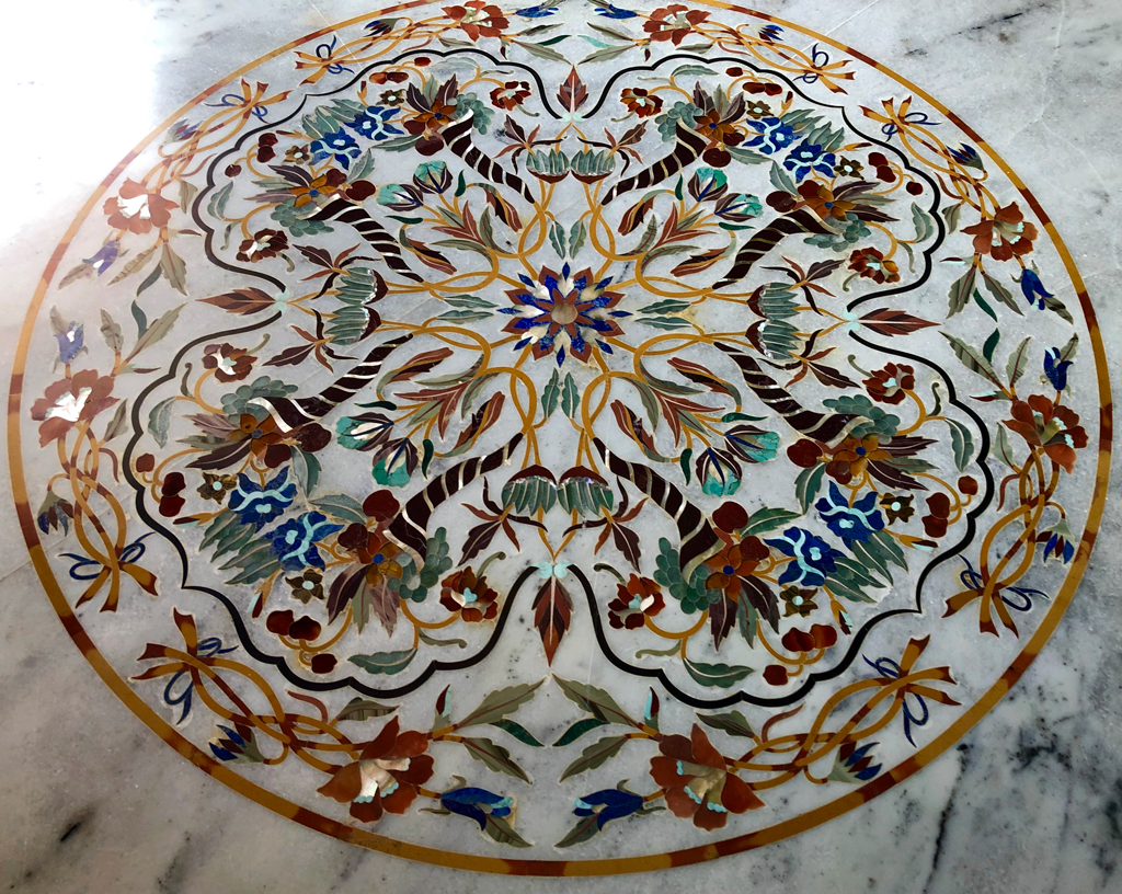 The temple flooring is made of marble with gorgeous inlay designs, similar to those found in Taj Mahal.