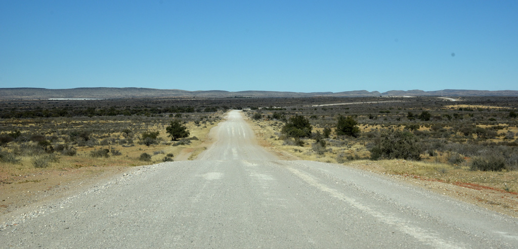 Driving on unpaved roads from Rehoboth to Namib-Naukluft National Park, through the vast open lands of Namibia.