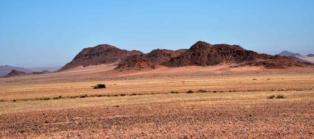 As we approached the Namib desert, the visions of red dunes started appearing on the base of otherwise rocky hills.