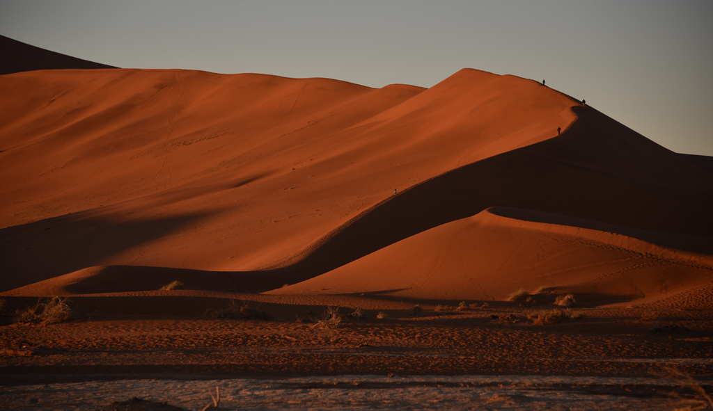 The foot of Big Daddy Dune in Sossusvlei, as seen from the parking lot. Check the tiny people climbing the red sand dune.