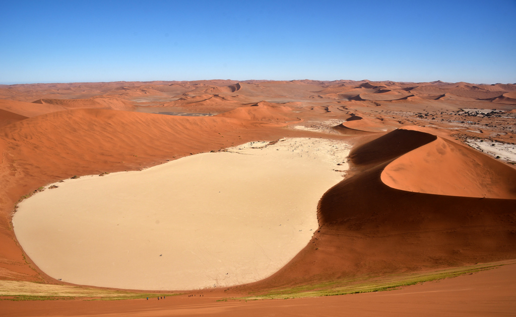 View from the top of Big Daddy Dune in Sossusvlei, Namibia. Notice the tiny specks in black. Those are people climbing down to Deadvlei.
