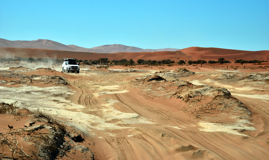 Driving on sand from the 2x4 Parking to Bid Daddy dune in Sossusvlei, in the red desert.