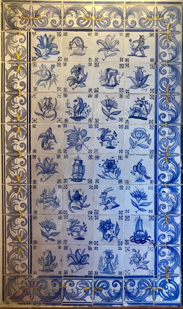 The interior of Pastéis de Belém is decorated with Portuguese blue tile art