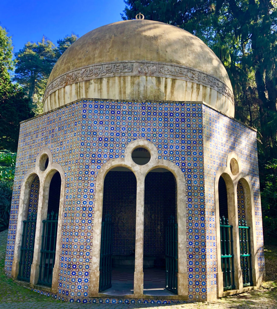 A small rest and drinking hut in Sintra's Pena Palace gardens is covered with tiles.
