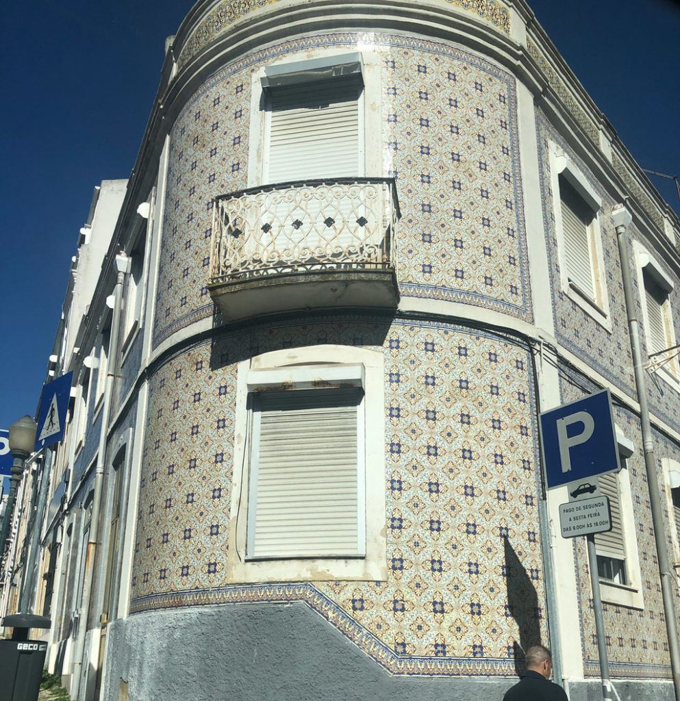 A newer looking building with beautiful tiles design in Lisbon.
