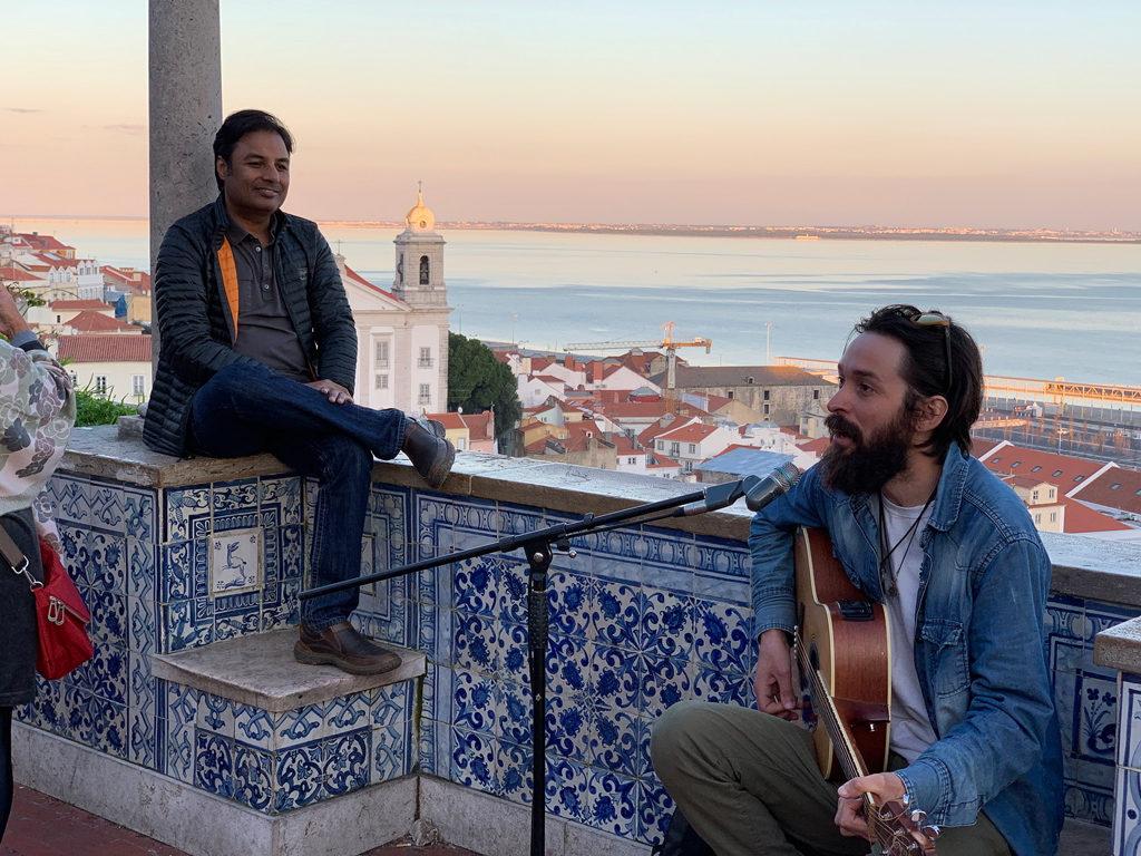 Live performances on Azulejos accompany the gorgeous sunset views over Alfama.