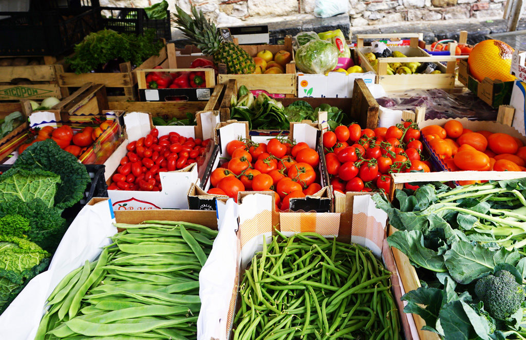 A traditional vegetable stall with fresh produce can be found nearly everywhere.
