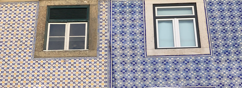 Neighbors with strikingly different tile colors and designs